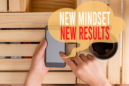 Text sign showing New Mindset New Results. Business photo showcasing obstacles are opportunities to reach achievement woman computer smartphone drink mug office supplies technological devices
