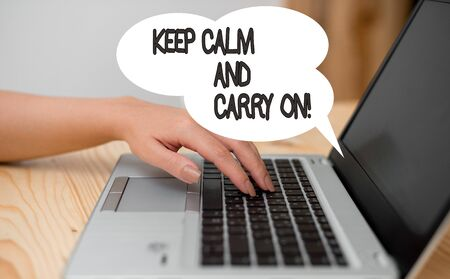 Writing note showing Keep Calm And Carry On. Business concept for slogan calling for persistence face of challenge woman with laptop smartphone and office supplies technology Stok Fotoğraf - 130608972