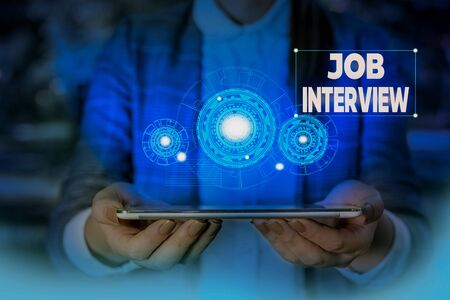 Handwriting text writing Job Interview. Conceptual photo Assessment Questions Answers Hiring Employment Panel Woman wear formal work suit presenting presentation using smart device 写真素材