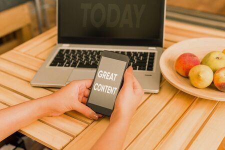 Conceptual hand writing showing Great Content. Concept meaning Satisfaction Motivational Readable Applicable Originality woman with laptop smartphone and office supplies technology