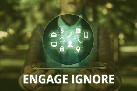 Text sign showing Engage Ignore. Business photo text Silent Treatment Manipulative Punishment Sulking Shunning