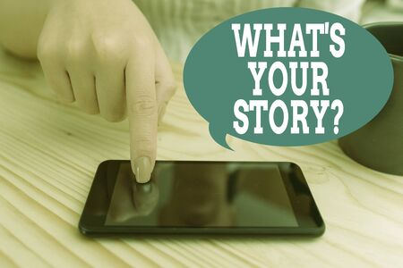 Text sign showing What S Is Your Storyquestion. Business photo text analysisner of asking demonstrating about past life events woman using smartphone office supplies technological devices inside home