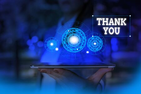 Text sign showing Thank You. Business photo text a polite expression used when acknowledging a gift or service Woman wear formal work suit presenting presentation using smart device