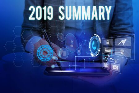 Text sign showing 2019 Summary. Business photo showcasing brief comprehensive especially covering the main points of 2019 Woman wear formal work suit presenting presentation using smart device Stock fotó