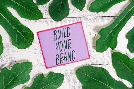 Writing note showing Build Your Brand. Business concept for enhancing brand equity using advertising campaigns
