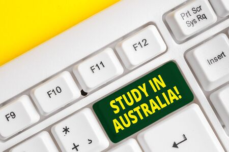 Word writing text Study In Australia. Business photo showcasing going into foreign country order complete your studies White pc keyboard with empty note paper above white background key copy space Stock Photo