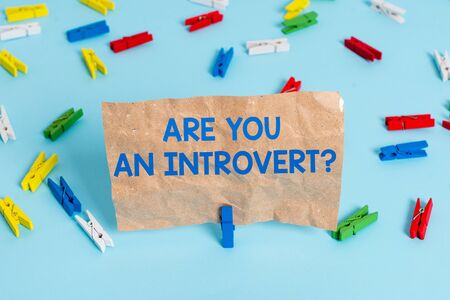 Text sign showing Are You An Introvertquestion. Business photo text demonstrating who tends to turn inward mentally Colored clothespin papers empty reminder blue floor background office pin