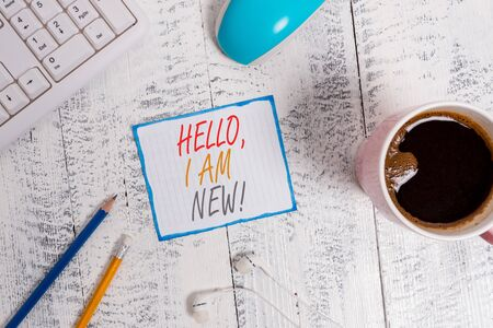 Writing note showing Hello I Am New. Business concept for introducing oneself in a group as fresh worker or student Technological devices colored reminder paper office supplies