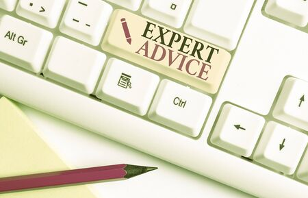 Handwriting text writing Expert Advice. Conceptual photo Sage Good Word Professional opinion Extensive skill Ace White pc keyboard with empty note paper above white background key copy space Stock Photo