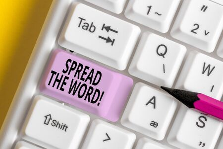 Conceptual hand writing showing Spread The Word. Concept meaning share the information or news using social media White pc keyboard with note paper above the white background