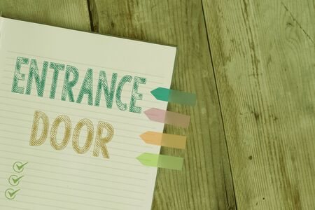 Handwriting text writing Entrance Door. Conceptual photo Way in Doorway Gate Entry Incoming Ingress Passage Portal Striped note book four colored arrow banners reminder wooden background