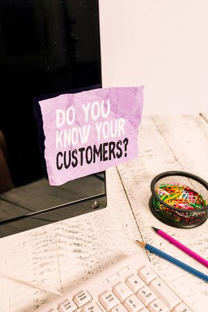 Word writing text Do You Know Your Customers question. Business photo showcasing asking to identify a customer s is nature Note paper taped to black computer screen near keyboard and stationary