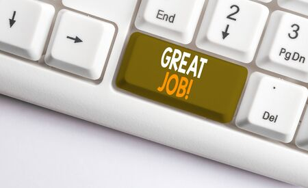 Text sign showing Great Job. Business photo showcasing sed for telling someone that they have done something well White pc keyboard with empty note paper above white background key copy space
