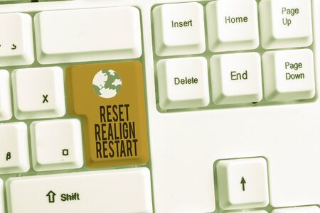 Writing note showing Reset Realign Restart. Business concept for Life audit will help you put things in perspectives White pc keyboard with note paper above the white background
