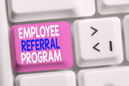 Handwriting text writing Employee Referral Program. Conceptual photo employees are rewarded for introducing recruits White pc keyboard with empty note paper above white background key copy space Stock Photo