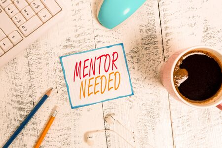 Writing note showing Mentor Needed. Business concept for wanted help for more experienced or more knowledgeable demonstrating Technological devices colored reminder paper office supplies