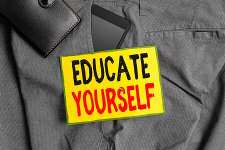 Conceptual hand writing showing Educate Yourself. Concept meaning prepare oneself or someone in a particular area or subject Smartphone device inside trousers front pocket with wallet Stock Photo