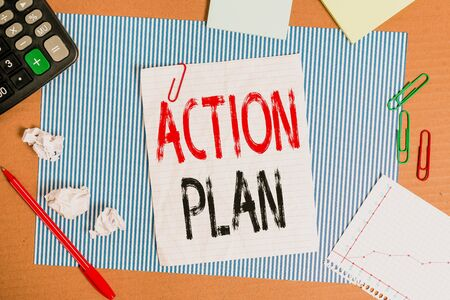 Text sign showing Action Plan. Business photo showcasing detailed plan outlining actions needed to reach goals or vision Striped paperboard notebook cardboard office study supplies chart paper