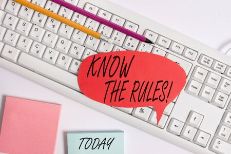 Word writing text Know The Rules. Business photo showcasing set explicit or regulation principles governing conduct Empty copy space red note paper bubble above pc keyboard for text message