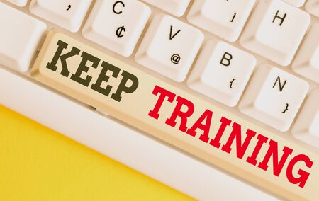 Text sign showing Keep Training. Business photo text Grounding Drilling Always Wonder Be Curious Learn White pc keyboard with empty note paper above white background key copy space