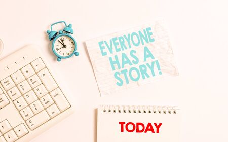 Text sign showing Everyone Has A Story. Business photo showcasing account of past events in someones life or career Blank paper with copy space on the table with clock and pc keyboard