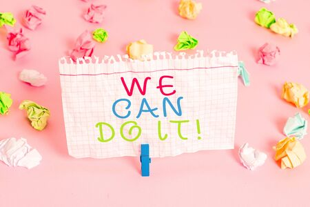 Conceptual hand writing showing We Can Do It. Concept meaning see yourself as powerful capable demonstrating Colored crumpled papers empty reminder pink floor clothespin