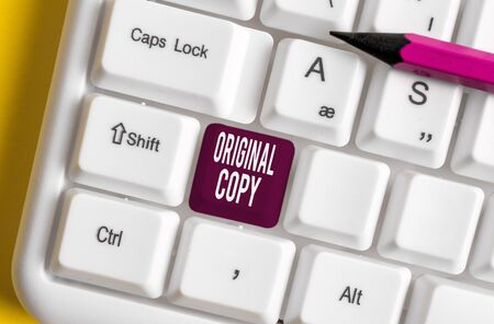Handwriting text writing Original Copy. Conceptual photo Main Script Unprinted Branded Patented Master List White pc keyboard with empty note paper above white background key copy space