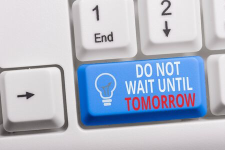 Writing note showing Do Not Wait Until Tomorrow. Business concept for needed to do it right away Urgent Better do now Keyboard with note paper on white background key copy space