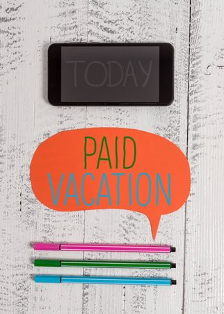Writing note showing Paid Vacation. Business concept for Sabbatical Weekend Off Holiday Time Off Benefits Smartphone cell pens blank colored speech bubble wooden background