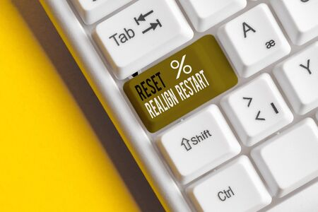Text sign showing Reset Realign Restart. Business photo showcasing Life audit will help you put things in perspectives White pc keyboard with empty note paper above white background key copy space Stock Photo