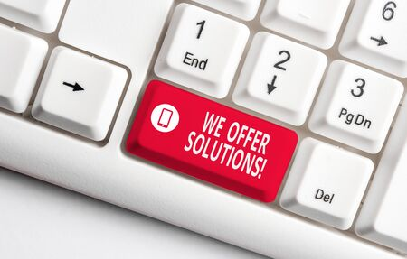 Text sign showing We Offer Solutions. Business photo text way to solve problem or deal with difficult situation White pc keyboard with empty note paper above white background key copy space 写真素材