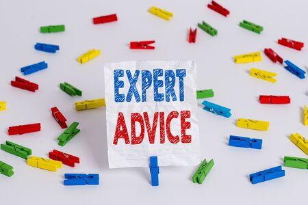 Text sign showing Expert Advice. Business photo showcasing Sage Good Word Professional opinion Extensive skill Ace Colored clothespin papers empty reminder white floor background office