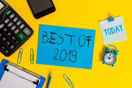 Writing note showing Best Of 2019. Business concept for great and marvelous things and events happened on 2019 Clipboard sheet calculator pencil clock smartphone color background