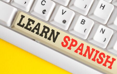 Text sign showing Learn Spanish. Business photo text Translation Language in Spain Vocabulary Dialect Speech White pc keyboard with empty note paper above white background key copy space Stok Fotoğraf