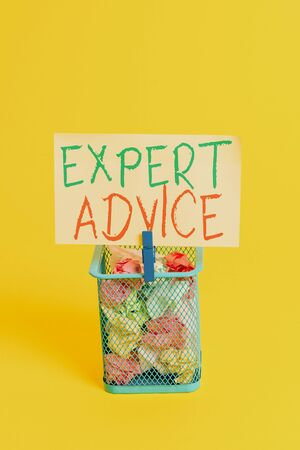 Handwriting text Expert Advice. Conceptual photo Sage Good Word Professional opinion Extensive skill Ace Trash bin crumpled paper clothespin empty reminder office supplies yellow Imagens