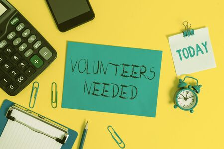 Writing note showing Volunteers Needed. Business concept for need work or help for organization without being paid Clipboard sheet calculator pencil clock smartphone color background