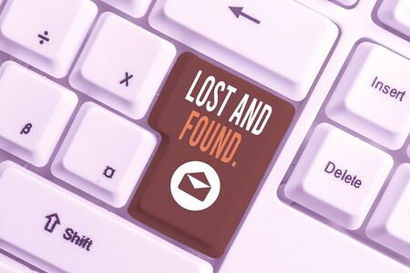 Conceptual hand writing showing Lost And Found. Concept meaning a place where lost items are stored until they reclaimed White pc keyboard with note paper above the white background