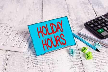 Text sign showing Holiday Hours. Business photo text employee receives twice their normal pay for all hours