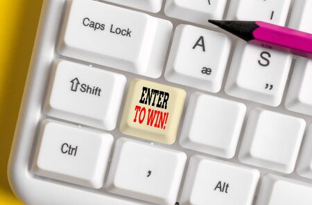 Text sign showing Enter To Win. Business photo showcasing exchanging something value for prize chance winning prize White pc keyboard with empty note paper above white background key copy space