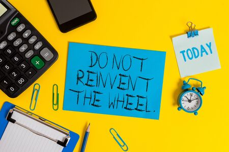 Writing note showing Do Not Reinvent The Wheel. Business concept for stop duplicating a basic method previously done Clipboard sheet calculator pencil clock smartphone color background Stockfoto
