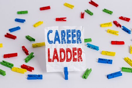 Text sign showing Career Ladder. Business photo showcasing Job Promotion Professional Progress Upward Mobility Achiever Colored clothespin papers empty reminder white floor background office Stok Fotoğraf