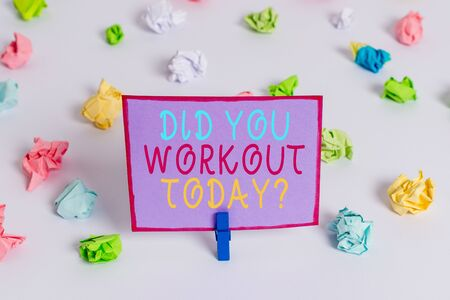 Writing note showing Did You Workout Today. Business concept for asking if made session physical exercise Colored crumpled paper empty reminder white floor clothespin