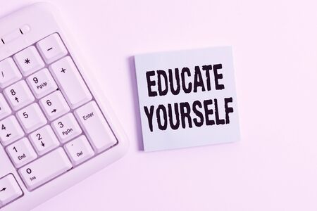 Word writing text Educate Yourself. Business photo showcasing prepare oneself or someone in a particular area or subject White pc keyboard with empty note paper above white background