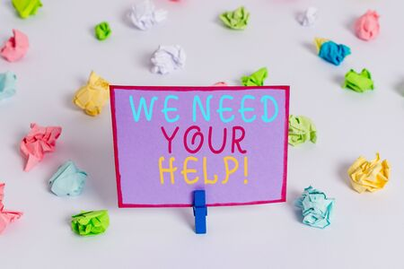 Writing note showing We Need Your Help. Business concept for asking someone to stand with you against difficulty Colored crumpled paper empty reminder white floor clothespin Stock Photo