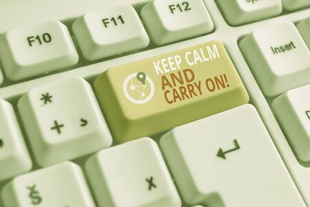 Word writing text Keep Calm And Carry On. Business photo showcasing slogan calling for persistence face of challenge White pc keyboard with empty note paper above white background key copy space
