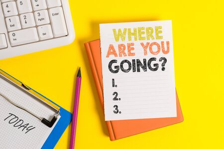 Writing note showing Where Are You Goingquestion. Business concept for used to ask someone the destination headed to Pile of empty papers with copy space on the table