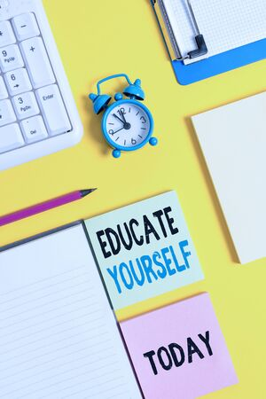 Conceptual hand writing showing Educate Yourself. Concept meaning prepare oneself or someone in a particular area or subject Crumpled white paper on table clock mobile and pc keyboard Stock Photo