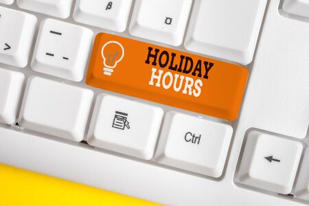 Word writing text Holiday Hours. Business photo showcasing employee receives twice their normal pay for all hours White pc keyboard with empty note paper above white background key copy space
