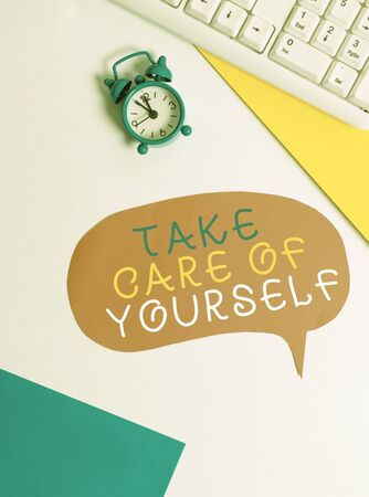 Handwriting text writing Take Care Of Yourself. Conceptual photo a polite way of ending a gettogether or conversation Flat lay with copy space on bubble paper clock and paper clips