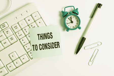 Conceptual hand writing showing Things To Consider. Concept meaning think about carefully especially in making decisions White pc keyboard with empty note paper above white background